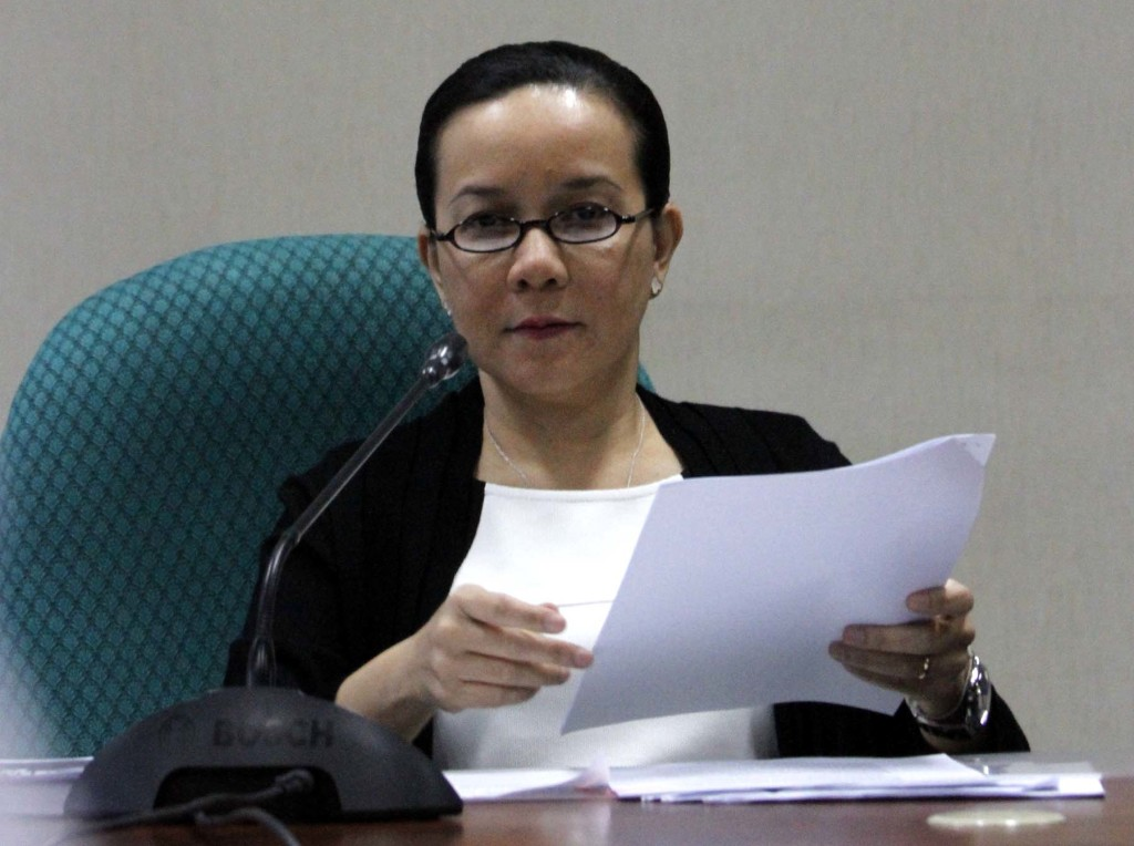 Senator Grace Poe, chairperson of the Senate Committee on Public Order and Dangerous Drugs, holds a copy of the Senate Committee Report on the Mamasapano Incident Investigation during a press conference on Tuesday (March 17, 2015) at the Senate Bldg. in Pasay City (PNA photo by Avito C. Dalan)