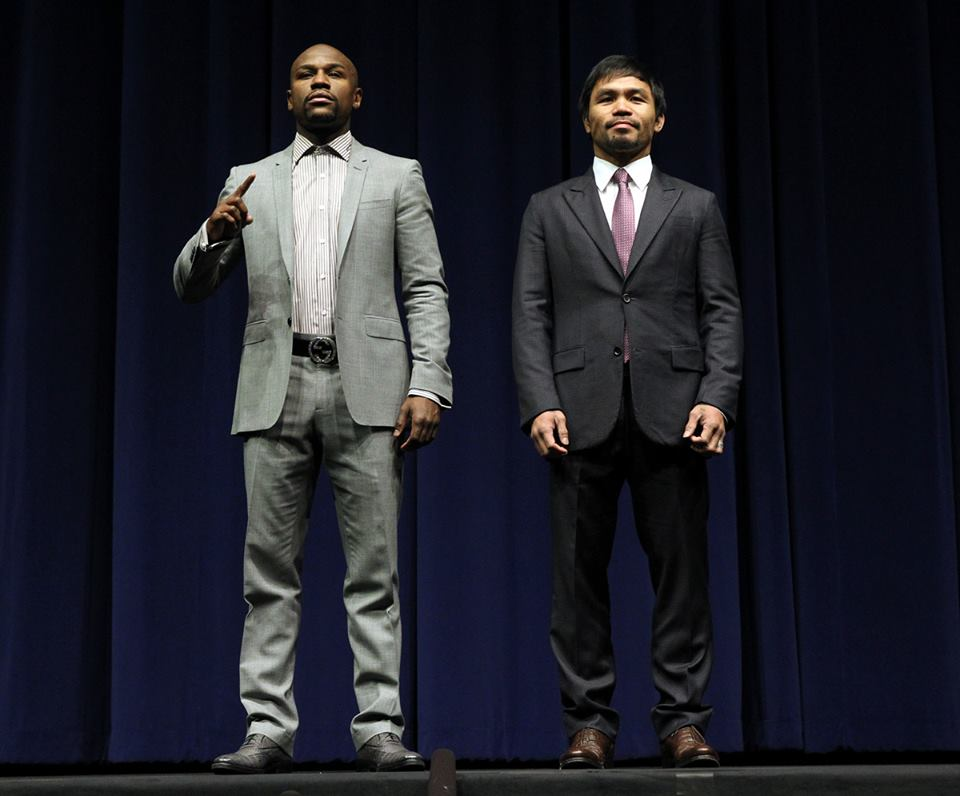BOXING'S FINEST: Floyd Mayweather Jr. (left) and Manny Pacquiao meet during their March 12 press conference for their fight on May 2 (Chris Farina / Top Rank / Pacquiao Facebook page)