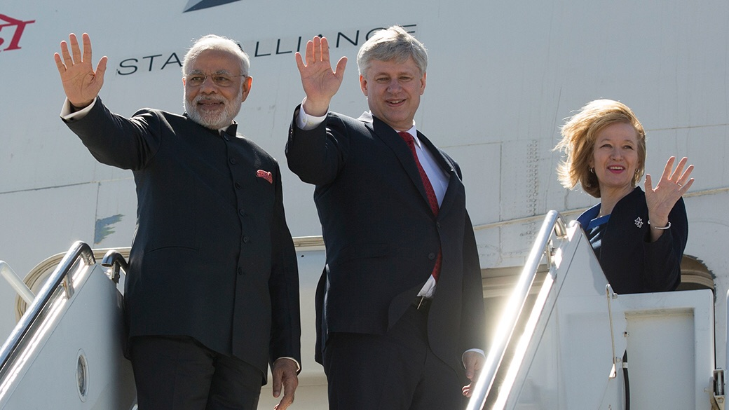 Prime Minister Stephen Harper and his wife Mrs. Laureen Harper share a laugh with Narendra Modi, Prime Minister of India at an event celebrating the special relationship that exists between Canada and India. (PMO photo by Jason Ransom / www.pm.gc.ca/media)