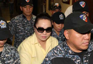 Makati City Regional Trial Court (RTC) Branch 150 Judge Elmo Alameda sentences alleged pork barrel scam mastermind Janet Lim Napoles (in yellow polo shirt) to a jail term of up to 40 years after finding her guilty of illegally detaining her former employee, whistle-blower Benhur Luy, on Tuesday (April 14, 2015). Judge Alameda also ordered Napoles to pay Luy PhP50,000 as civil indemnity and PhP50,000 as moral damages. The court likewise ordered Napoles' transfer from Camp Bagong Diwa in Taguig City to the Correctional Institution for Women in Mandaluyong City. (PNA photo by Avito C. Dalan)