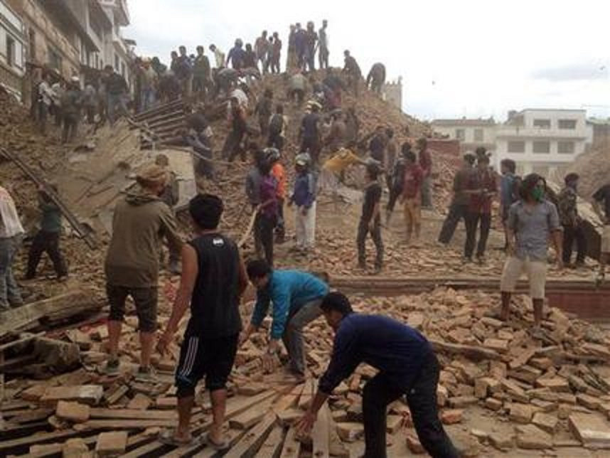 Locals and volunteers help dig through the rubble after a 7.8-magnitude earthquake hit Nepal on Saturday, April 25 (screenshot from AP footage)