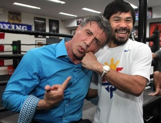 Manny 'Pacman' Pacquiao goofs around with Sylvester Stallone as the latter visited him during his training at the Wild Card Boxing Gym. (Photo by Chris Farina)