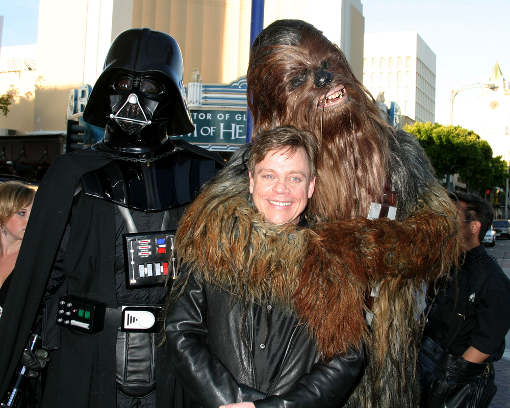 "Mark Hamill with Drath Vader and Chewbacca at the ""Star Wars 3 : The Revenge of the Sith"" Premier, Mann's Village Theater, Westwood, California in 2005. (Carrie-Nelson / Shutterstock)"