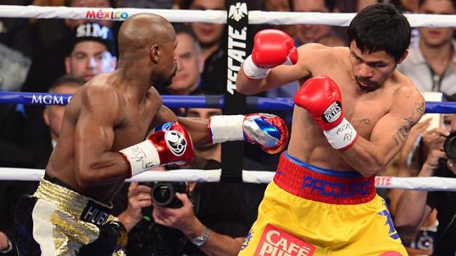"""Filipino boxing icon Manny """"Pacman"""" Pacquiao and American undefeated boxer Floyd """"Money"""" Mayweather Jr. during their megabout last May 2 at the MGM Grand Garden Arena, Las Vegas. (AFP photo)"""