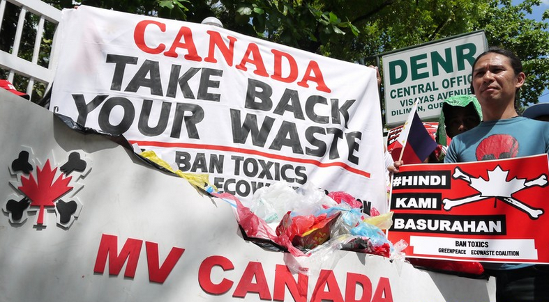 Environmental, public health and labor groups protest against Canada's illegal export of household wastes and hazardous materials to the Philippines. (Photo by Paeng Lopez)