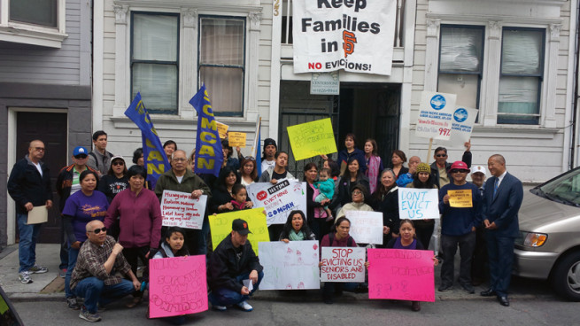 Filipino families and community groups protest against home evictions. (Photo courtesy of Asian Journal)