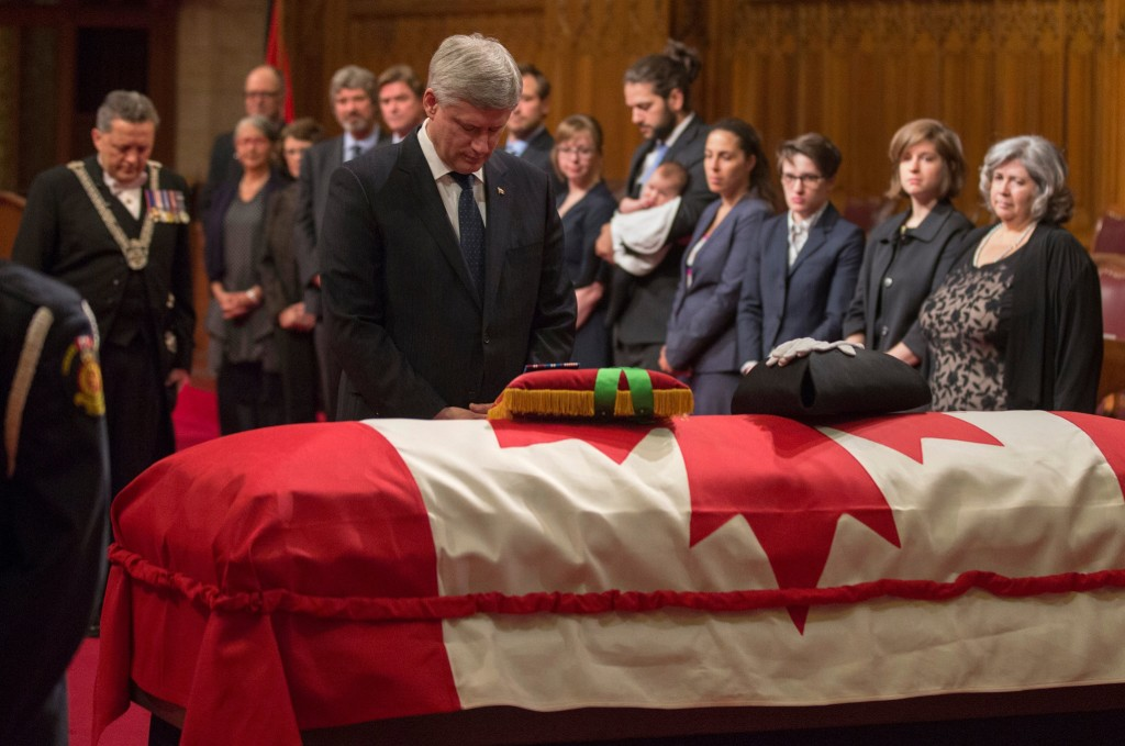 Ottawa – Prime Minister Stephen Harper pays his respects to the late Honourable Pierre Claude Nolin, Speaker of the Senate, during a special ceremony in the Senate Chamber. (PMO photo by Jason Ransom / pm.gc.ca)