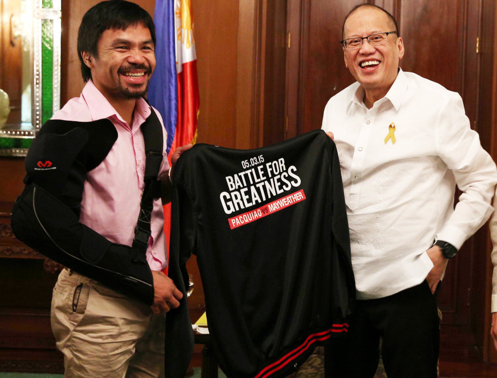 "President Benigno S. Aquino III receives a black jacket from Sarangani Lone District Representative Emmanuel ""Manny"" Pacquiao during the courtesy call at the Music Room of the Malacañan Palace on Wednesday (May 13, 2015). (Photo by Ryan Lim / Malacañang Photo Bureau)"