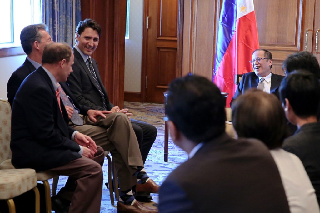 The Leader of the Liberal Party of Canada, Justin Trudeau, and Liberal MPs John MacKay and Kevin Lamoureux meet with the President of the Philippines, Benigno Aquino III, in Toronto.