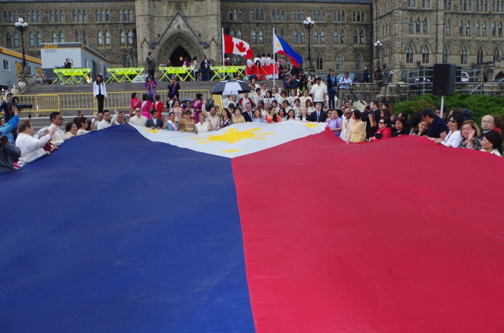 A giant Philippine flag is unfurled at Parliament Hill