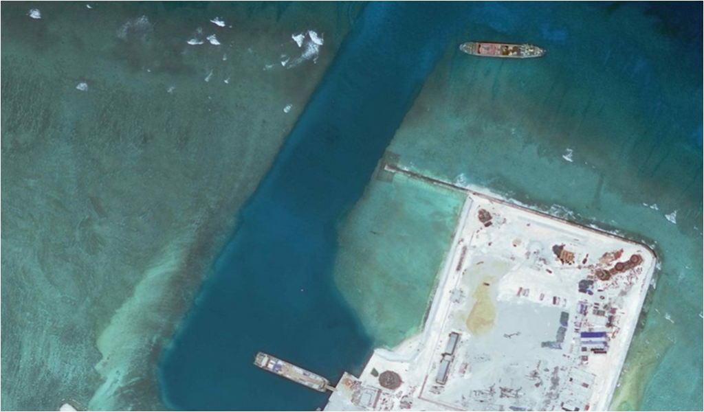 Since 2014, China has been building an artificial island at Calderon Reef (Cuarteron Reef) and is also building structures on the island. (Photo courtesy of Asia Maritime Transparency Initiative)
