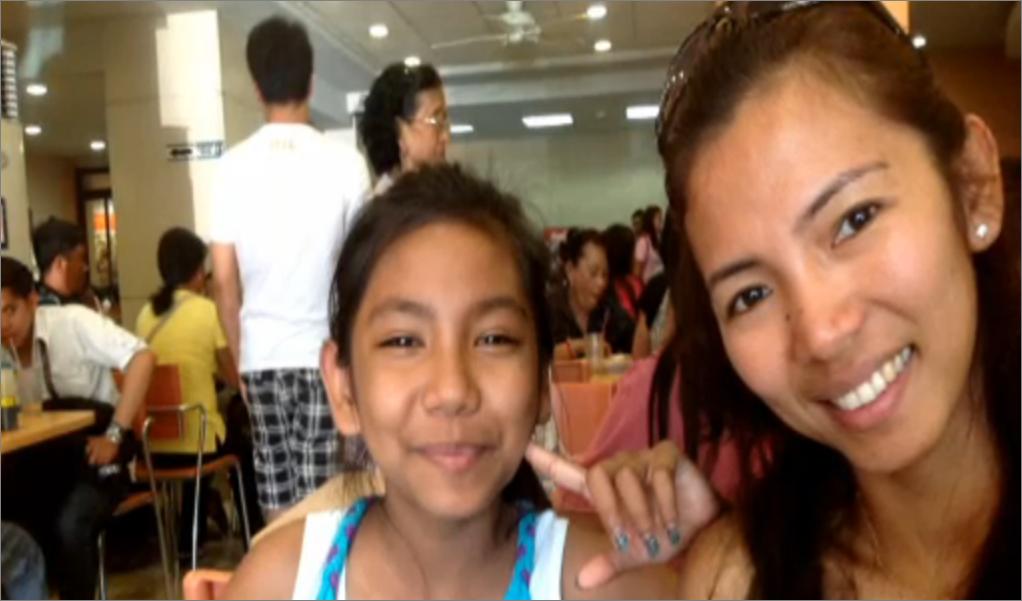 Filipina caregiver Karen Talosig and daughter Jazmine (Photo screengrab from CBC News report)