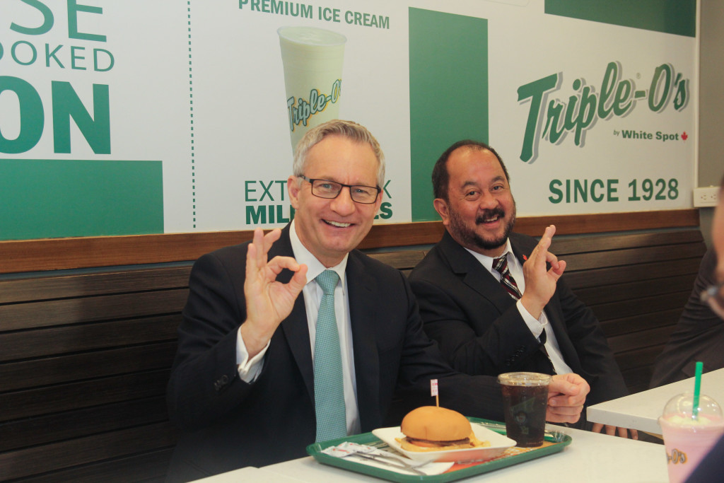 Minister Fast and Senator Enverga enjoy burgers made from Canadian beef at Triple-O's