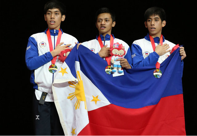 Dustin Jacob Mella, Rodolfo Reyes Jr and Raphael Enrico Mella win gold (Photo via Reuters)