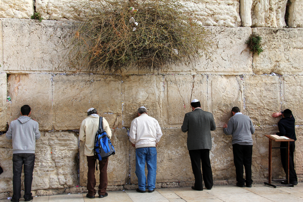 Unidentified Jewish worshipers pray at the Wailing Wall an important jewish religious site in Jerusalem, Israel. (shutterstock)