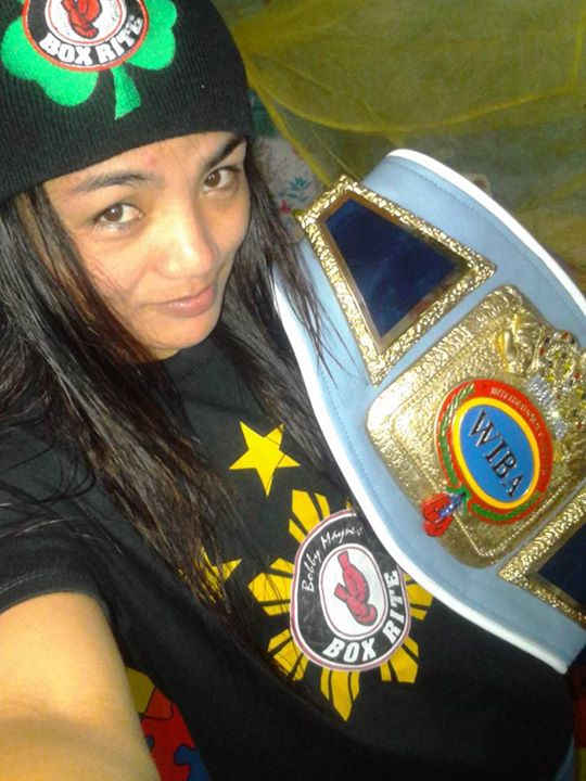 Filipina flyweight champion Jujeath Nagaowa holding her WIBA world title belt. (Photo from Nagaowa's Facebook account)