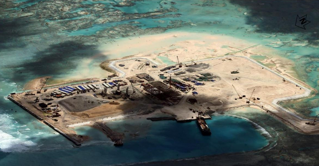 Chinese development at the Cuarteron Reef which is located on the Western side of the Spratly Islands (Photo from the Asia Maritime Transparency Initiative)