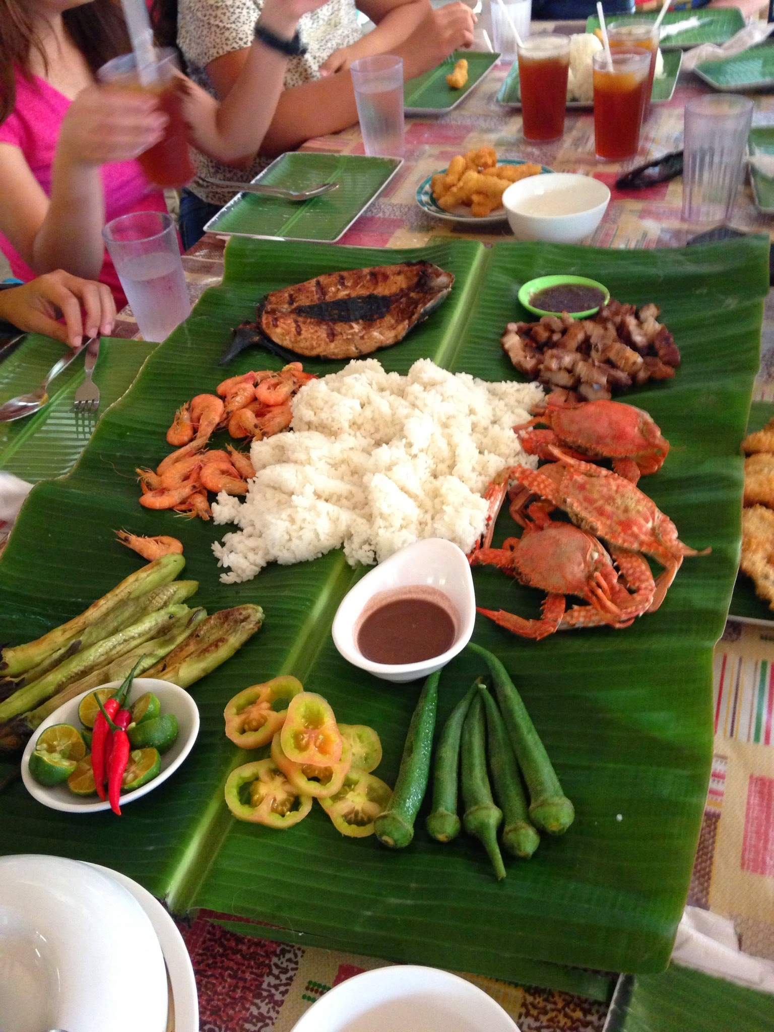 Seafood bounty served FIlipino style--on a bed of banana leaves