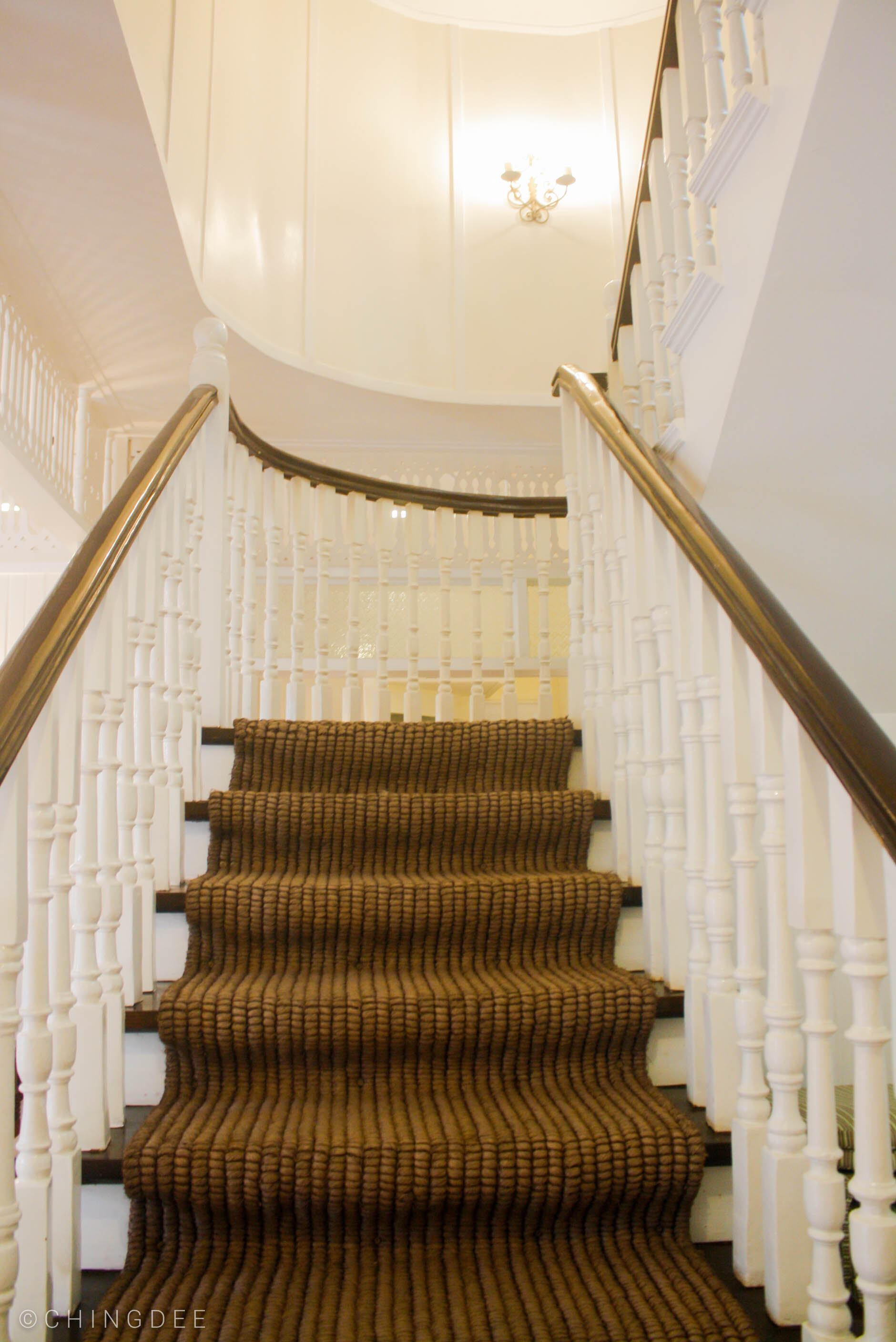 The staircase lined with the restored abaca rug