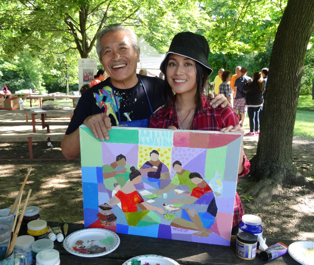 "World-renowned UNICEF artist Manuel Baldemor and artist / PMNTV host Michelle Chermaine collaborating on an abstract painting inspired by Baldemor's recollection of the late Jose P. Alcantara's sculpture ""Hapunan."" Michelle is the grandniece of Jose P. Alcantara."