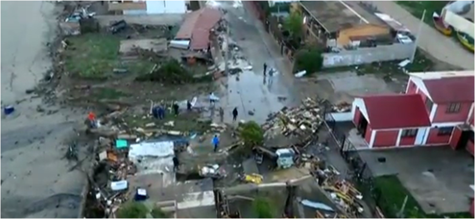 Aftershocks after Chile earthquake left coastal towns devastated, killing at least 11 people. (Screengrab from The Guardian's video)