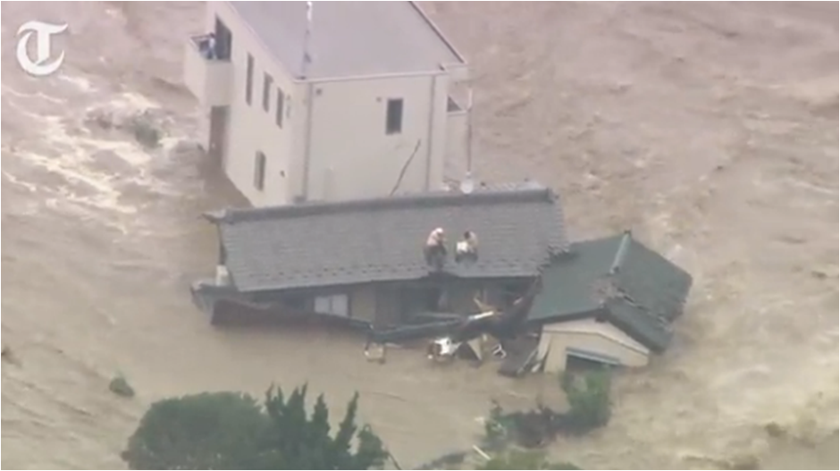 Residents in Joso, Japan wait for rescue helicopters.  (Screengrab from The Telegraph video)