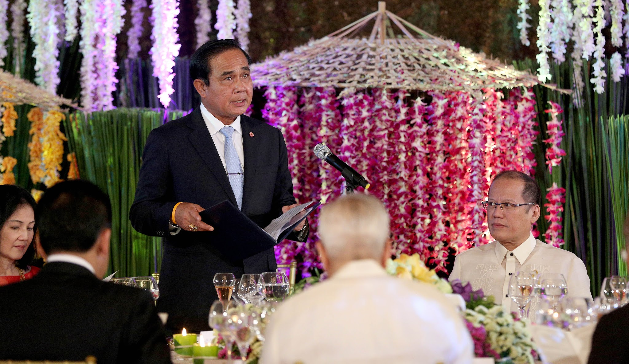 President Benigno S. Aquino III listens as His Excellency General Prayut Chan-o-cha, Prime Minister of the Kingdom of Thailand, delivers his message during the State Luncheon at the Rizal Hall of the Malacañan Palace for the Official Visit to the Philippines on Friday (August 28, 2015). This is the Thai Prime Minister's first visit to the Philippines since assuming office in August 2014. This visit hopes to deepen the Philippines' partnership with Thailand, a fellow founding member of ASEAN and a long-time friend. Thailand is the Philippines' 8th largest trading partner in 2014, with total two-way trade amounting to US$ 5.83 billion. The Philippines and Thailand enjoy excellent and cordial relations at the bilateral, regional, and multilateral levels. (Photo by Robert Viñas/ Malacañang Photo Bureau)
