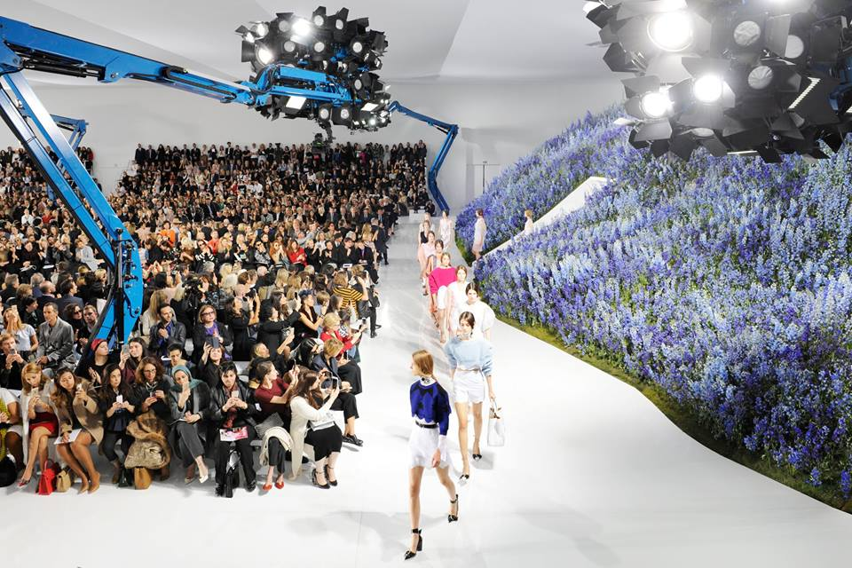 An entire mountain, replete with flaming blue blooms which glistened in the sun, was the near-impossible feat of creation that powerhouse Christian Dior achieved for their Friday show. (Photo from Dior's official Facebook page)