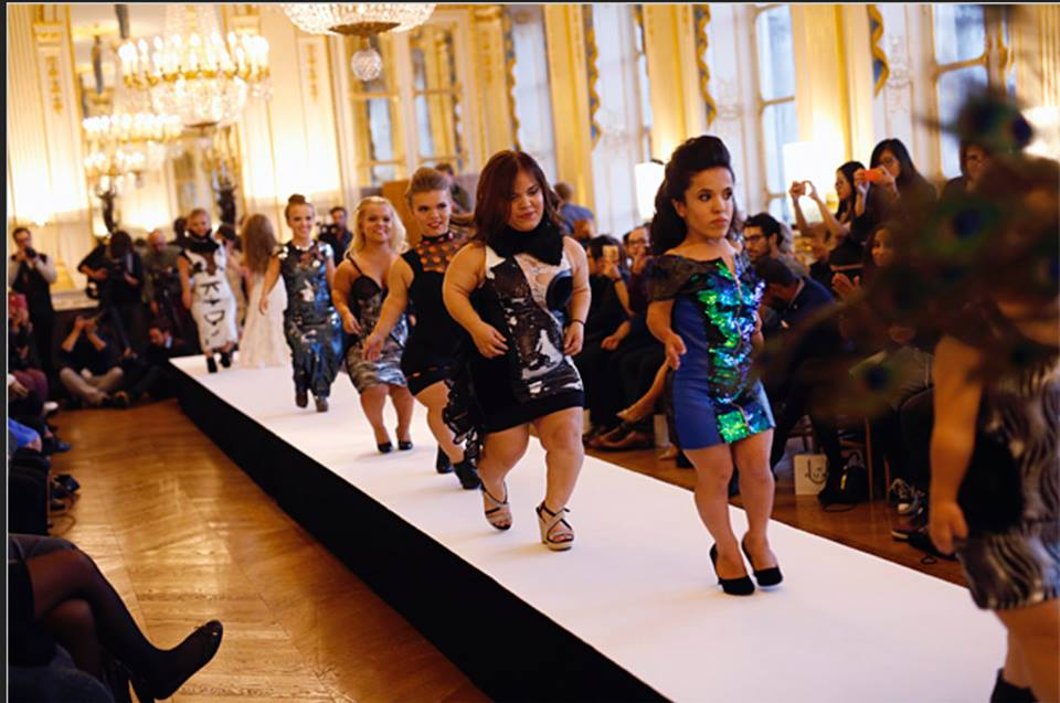 Fifteen women dwarves all measuring under 4 feet 4 inches (1.22 meters, 10.16 centimeters) trod the boards proudly in the latest colorful spring-summer fashions, designed by a team of designers for the show. (Photo from The National Dwarf Fashion Show's Facebook page)