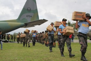Philippine Air Force together with the Philippine Army, Philippine National Police, Bureau of Fire Protection and other Local Government Units joined in unloading from C-130 relief goods in Baler and Casiguran last October 21, 2015. (Photo by: A1C Yupangco, PIO-PAF)