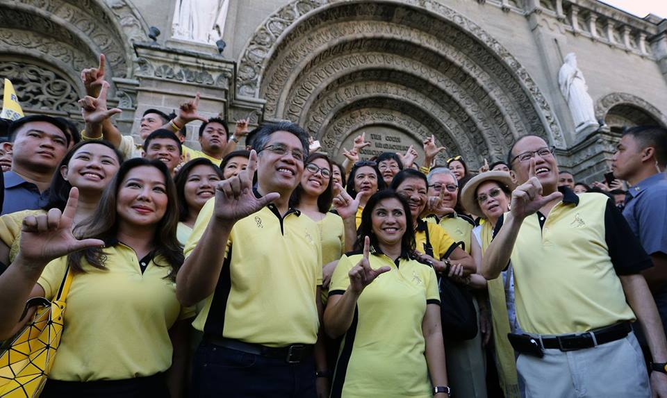 President Benigno S. Aquino III with Liberal Party (LP) standard bearers Mar Roxas and Leni Robredo are greeted by supporters outside Manila Cathedral as they walk to Commission on Election building to file their Certificate of Candidacy, Thursday, October 15, 2015. Tomorrow, Friday, October 16, 2015 is the deadline of filing of candidacy for the 2016 elections. (Joseph Vidal / Malacanang Photo Bureau)