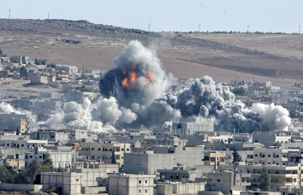 Coalition forces hitting to ISIS target in Kobani district in Syria in October 2014 (Orlok / Shutterstock)