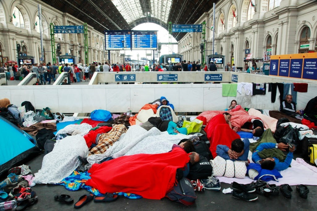 Syrian refugees at Budapest Keleti railway station, 4 September 2015 (Photo from Wikipedia/Rebecca Harris)