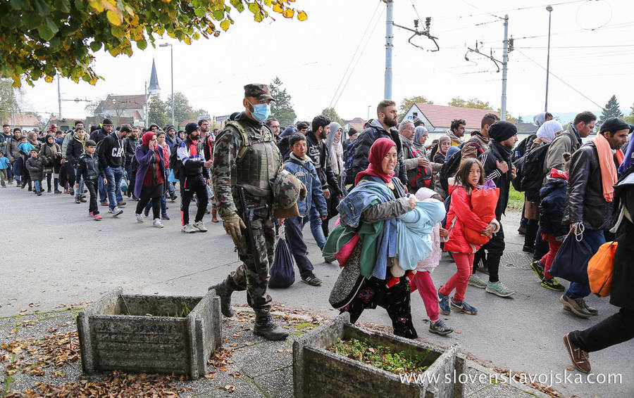 Syrian refugees and migrants, mostly from Afghanistan, Bangladesh, Pakistan, pass through Slovenia on their way to Germany, 23 October 2015 (Photo from Wikipedia/Slovenian Armed Forces website)