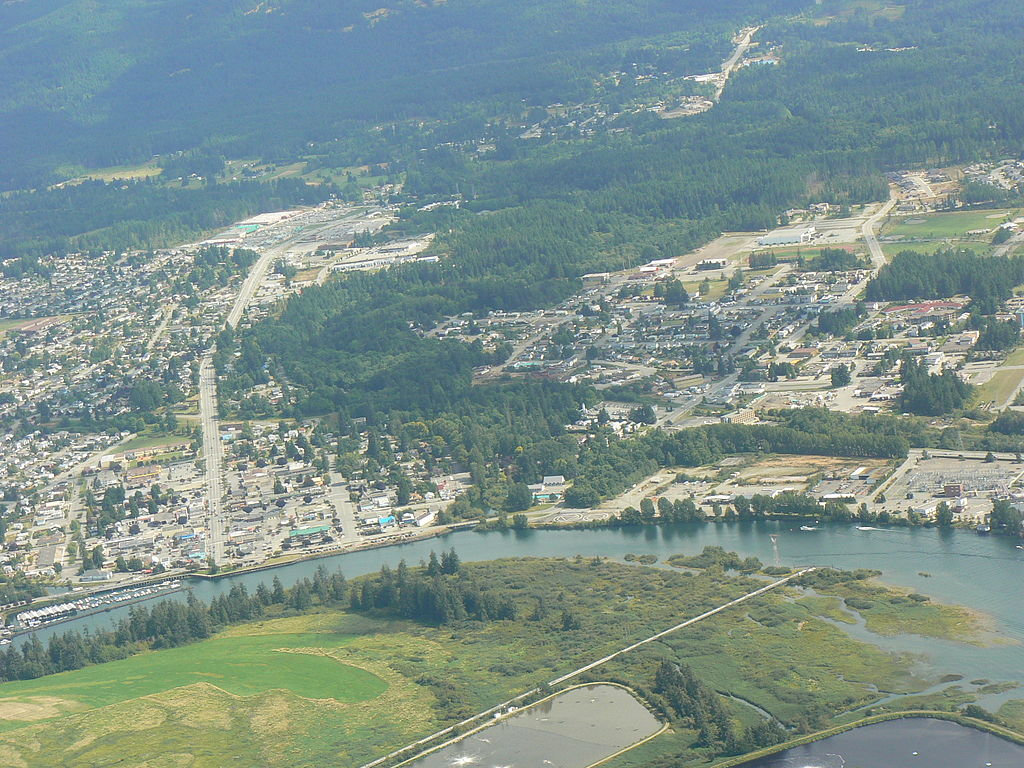 Aerial view of central Port Alberni showing the Somass entering the Alberni Inlet. (Photo from Wikipedia/ Kevstan)