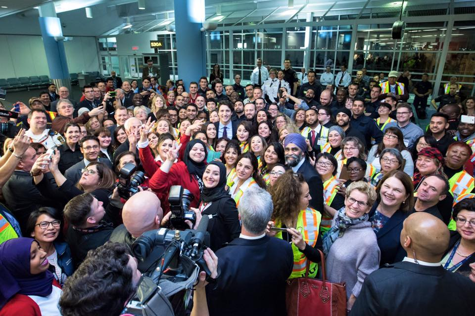 Prime Minister Justin Trudeau with Syrian refugees who have arrived in Canada (Photo from Prime Minister Trudeau's official Facebook page)