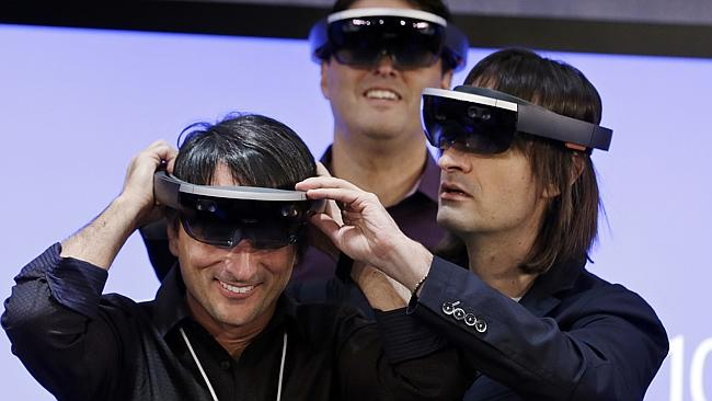 Microsoft software developers having their hands-on demonstration on HoloLens headset (Internet photo)