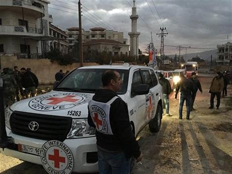 A convoy carrying food, medical supplies and other items. Photo courtesy of the The International Committee of the Red Cross (ICRC), Syrian Arab Red Crescent (SARC) and the United Nations (UN).