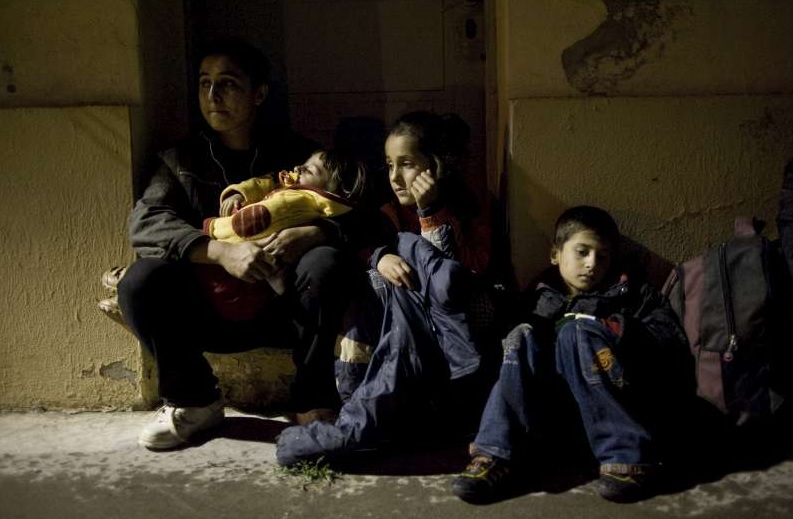 A Syrian family reaches Greece.  (Photo by Mathias Depardon/United Nations Commission on Human Rights)