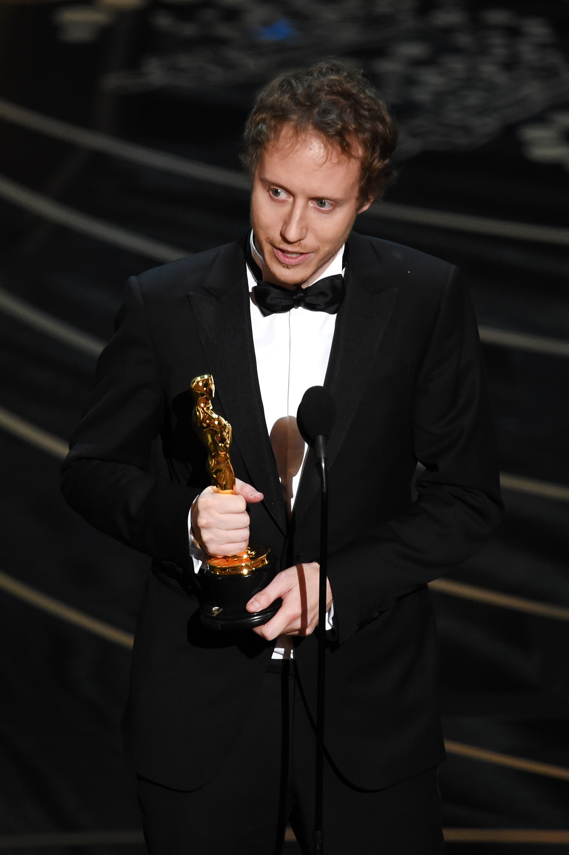 Laszlo Nemes, director of Son of Saul, receives the award for Best Foreign Language Film at the 88th Annual Academy Awards. (Photo courtesy of The Oscar)