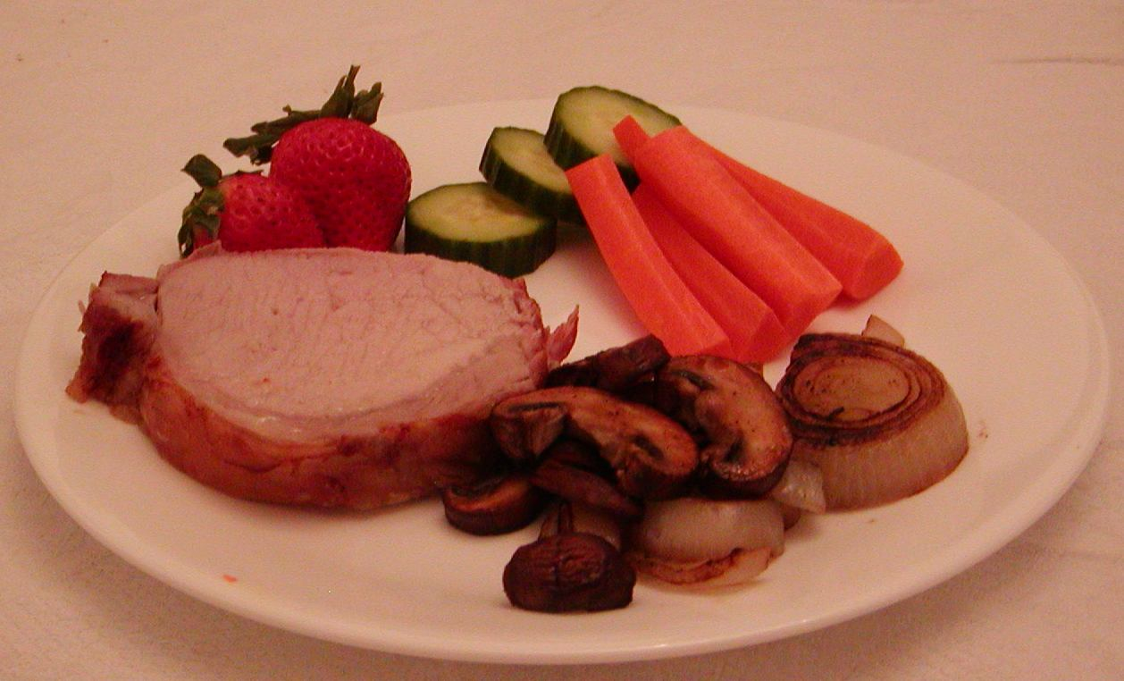 Paleolithic-style dish: Roast pork with cooked and raw vegetables and fruit (Photo courtesy of Warren Dew/Wikipedia).
