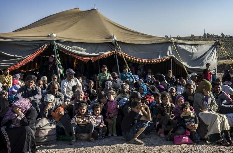 Syrian refugees in a military camp in Jordan. (Photo courtesy of the United Nations Commission on Human Rights/O. Laban-Mattei)