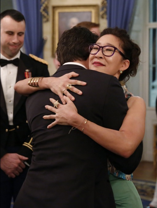 Prime Minister Justin Trudeau hugs actress Sandra Oh during the state dinner at the White House.