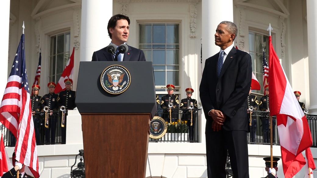 Prime Minister Justin Trudeau (left) addresses crowd while US President Barack Obama (right) listens. (Photo: The Prime Minister's website)