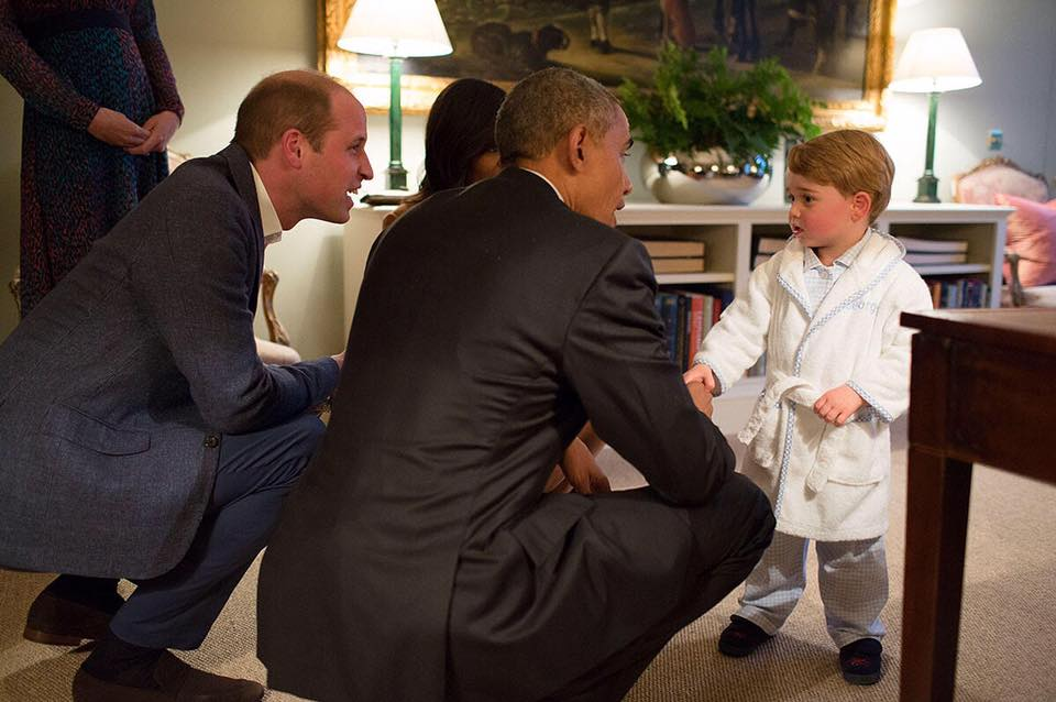 The palace later released a series of photos showing everyone chatting in the drawing room of William and Kate's home, and of Obama kneeling in front of George, who appeared ready for bed in pyjamas and a robe. (Photo: The British Monarchy/Facebook)