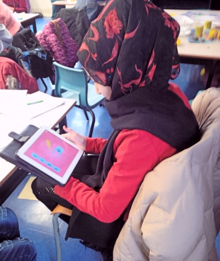 A student from Syria at Joseph Howe School learns English words on an iPad. (Photo: Joseph Howe School/Twitter)
