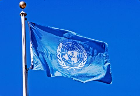 The flag of the United Nations flies from a pole in front of UN Headquarters. (UN Photo/John Isaac)