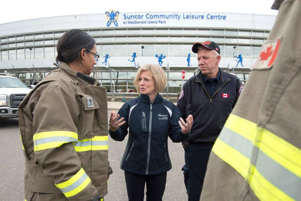 Premier Rachel Notley met with the first responders and Fire Chief Darby Allen in Fort McMurray, thanking them for their efforts in battling the fires. (Facebook photo)