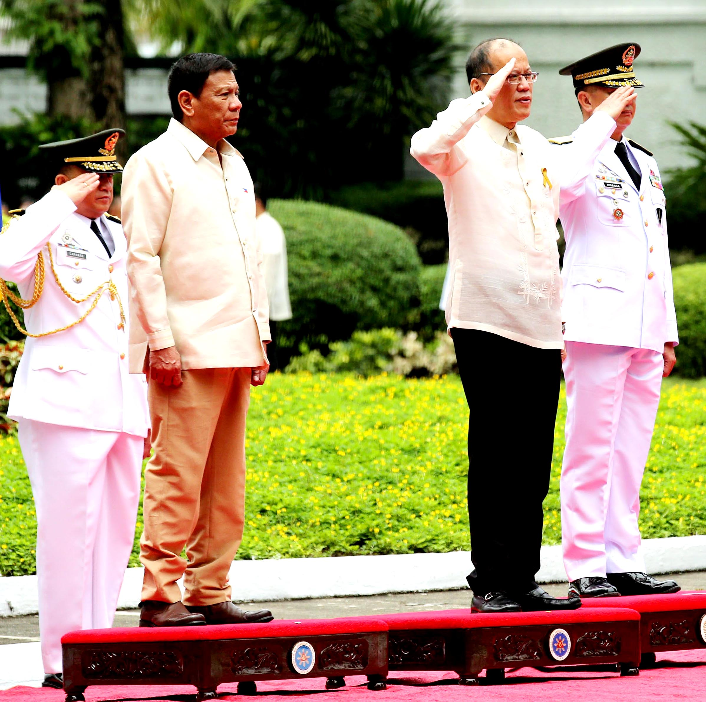 Outgoing President Benigno S. Aquino III salutes during the departure honors accorded for him at the Malacañang Grounds on Thursday (June 30, 2016). Also in photo is incoming President Rodrigo R. Duterte. (Photo: Lauro Montellano Jr./Malacañang Photo Bureau/PNA)