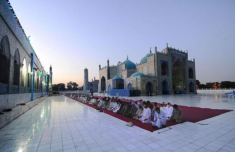 Men praying during Ramadan at the Shrine of Hazrat Ali in Afghanistan.  (Wikipedia photo)